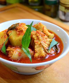 asam pedas keladi sarawak (Another dish that makes use of the sour-spicy-fishy trinity. Fish and, usually, okra are simmered in a tamarind-based broth that, as in so many dishes, starts with a pounded spice paste of chilis and roots and belacan.)