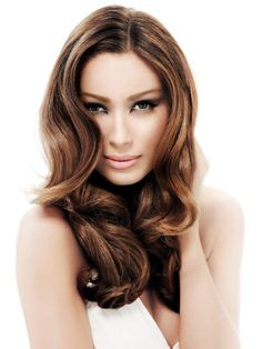 Long glossy, wavy brunette hairstyle by Paul Mitchell