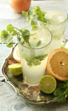 Upgrade your Gin and Tonic with Cilantro, Grapefruit and a twist of lime for a refreshing Summer Cocktail.