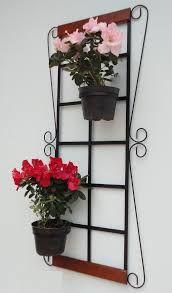 Resultado de imagem para suporte para vasos