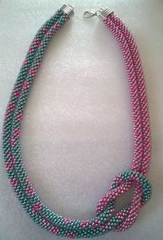 Kumihimo two colour offset knot necklace by FoxesJewellery on Etsy Diy Jewelry Necklace, Jewelry Crafts, Beaded Necklace, Knot Necklace, Jewellery, Bead Crochet Patterns, Beaded Jewelry Patterns, Crochet Bracelet, Handmade Jewelry Designs