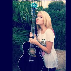 Singer Alexi Blue kissing her black Taylor guitar :)