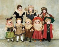 Small Courtesies: 270 Eight German All-Bisque Dolls with Original Costumes