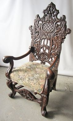 carved walnut throne chair with unusual detail fly carving in back 56 x 32 x 24 Auction Estima.