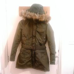 Brand new women's green kaki parka with smooth racoon fur around the hood. Size M. Waterproof, very comfortable double lining for the cold winter. It stops the wind and keeps you very warm. Only wore it twice, it is a bargain!! If you are interested drop me a message!