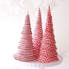 A paper Christmas tree made from cupcake liners and a polystyrene cone.
