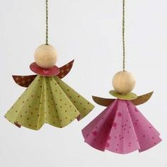 This origami angel craft idea is perfect for decorating the Christmas tree or hanging around your home and can be made in complimentary colours to match any Christmas theme. Our origami angel and its twin are both wearing a dress, a collar and wings, mad Angel Crafts, Christmas Crafts, Christmas Decorations, Useful Origami, Origami Easy, Dollar Origami, Paper Ornaments, Xmas Ornaments, Christmas Origami