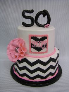 Amy's 50th birthday cake - Chevron, used Marvelous Molds. Worked great. Fondant cake w/ gumpaste flowers and topper.