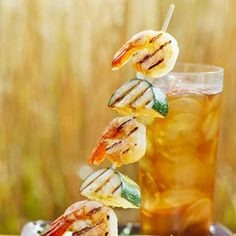 Skewered Shrimp and Zucchini with Basil Cream Sauce A whirled-together, fat-free basil-and-chive sour cream sauce makes a soothing counterpoint for the low-calorie cayenne- and orange-brushed shrimp in this grilled main dish recipe.