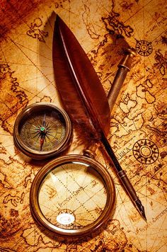 Vintage magnifying glass lies on an ancient world map is part of Ancient world maps - Vintage magnifying glass, compass, goose quill pen, spyglass lying on an old map Karten Tattoos, Map Compass, Compass Navigation, Nautical Compass, Compass Tattoo, Treasure Maps, Pirate Treasure, Pirate Life, Old Maps