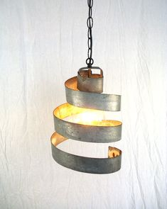Gorg hanging over my dining room table!  Wine Barrel Ring Hanging Pendant Light - 100% RECYCLED from Napa Wine Barrels. $40.00, via Etsy. For your farmhouse industrial, @Elisha Rivers
