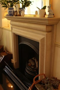 Hand-carved traditional stone fireplace