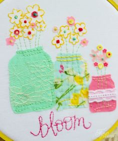 Fabric flowers with an embroidered french knot centre - could use buttons for the flowers too..