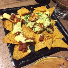 #New #Vegetarian #Restaurant in town @bombaycartel @atriamallworli  This is Breaking News aka #Nachos with #mexicanbeans �� The place is typically a #sheesha #lounge has board #games on weekdays and has an elaborate #veg menu.. do check it out! It has #quirky interiors and a cartel+mafia like theme to it..great #vibe and amazing #food…
