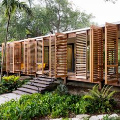 Wooden shutters swing open to reveal Miami house by Brillhart Architecture