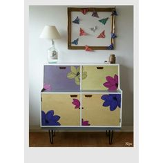 Sideboard re-looked by me using paint, patina, wax, wallpaper patterns, the top is covered in broken tiles and I changed its legs for hairpin legs. It's a unique colorful one! And I love flowers! :)