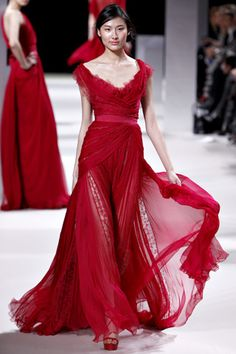 Elie Saab red gown. Ideal skirt, floaty, flowy, sheer with shorter mini skirt underneath.  V Neck, top part of dress ideally embellished with aplique, lace or beading.  #TopShopPromQueen
