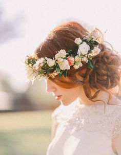 similarly, I like how this is not too big or too small, has smaller flowers and greenery and looks more focused to one side (not blocking the brides face)