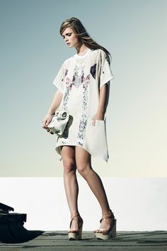 simple tee shirt dress with mixed prints, asymmetrical hem and deep pockets.
