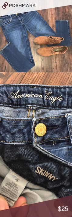 American Eagle skinny jeans American eagle stretch skinny jeans - size 4long. Awesome medium to dark blue wash. Very comfortable & flattering! Closet must have! American Eagle Outfitters Jeans Skinny