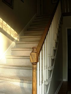 I have always wondered what the stairs would look like if I took the carpet off!! I am so doing this...