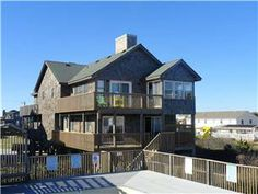 Causal Cove is a unique oceanfront duplex in South Nags Head, with just four units to share the large oceanfront pool and dune top decking. This home ...