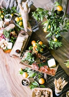 10 Totally Gorgeous Garden Wedding Ideas: Lighter fare is perfect for this time of year, so why not serve guests a variety of fruits, cheeses, and charcuterie? Photo by Nancy Neil; Styled by Kelly Oshiro