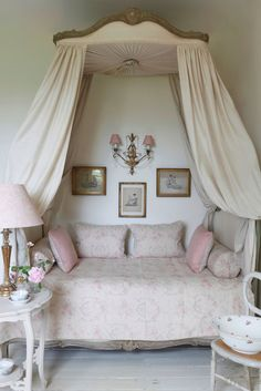 Kate Forman Textiles Girls canopy bed in this elegant feminine girls bedroom creates the perfect private hideaway.  Scone and lighting are perfect for reading.  Gorgeous pastel bedding.