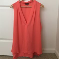 Coral sleeveless top Beautiful coral sleeveless top. Only worn once! Great alone with jeans, shorts or pants. Pairs great with jackets and Blazers. Vince Camuto Tops Blouses
