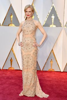 Dazzling Damsel: Nicole Kidman in a custom made, nude-colored Armani Privé gown, with glittering silver embroidery at the 2017 Oscars