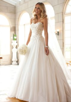 This Soft Organza designer ball gown is crafted with lovely accents of Lace and exquisite beading. It comes with a highly-detailed Dolce Satin detachable belt.  The Knot provides price estimates to give you a general idea of the cost of a dress. Please visit retailers in your area for exact pricing. Prices will vary by region.