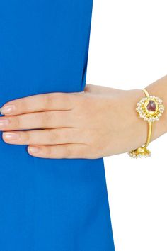 Gold plated amethyst and pearl bangle available only at Pernia's Pop-Up Shop.