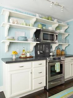 This shelving on either side of large stove vent hood- but maybe in an aged grey color