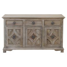Stow board games and gaming accessories in the den or display an eye-catching vignette in your dining room with this handsome sideboard, showcasing carved fr...