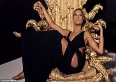 Cookie on her throne: Taraji also posed in a sexy black cut-out gown
