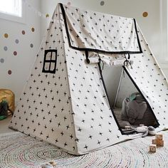 This sturdy playhouse will provide the perfect foundation for your kid's imaginary adventures. Made from durable cotton canvas, it has two cutout windows and a roll-up door flap. Plus, its print is so stylish your actual house might get a bit jealous.