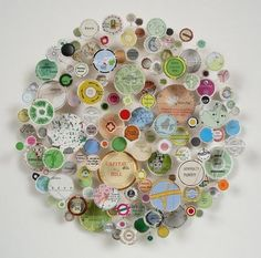 These 3-Dcollage piecesconstructed fromfragments of maps, strips of found text,and 3-Dobjects are byartist Chris Kenny . To see mor...