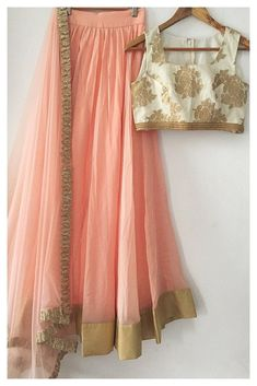 This uber feminine lehenga set is in a dusty peach georgette finished with gold brocade borders. The ivory blouse is a pure silk brocade. The dupatta is in soft net with gota border. This lehenga is available for bulk bridesmaid orders. Pakistani Dresses, Indian Sarees, Indian Dresses, Indian Bridesmaids, Bridesmaid Outfit, Indian Wedding Outfits, Indian Outfits, Indian Reception Outfit, Indian Attire
