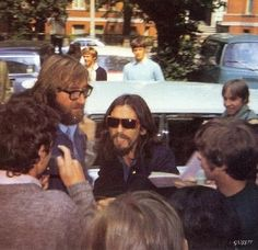 Mal Evans and George Harrison (being mobbed, July 1969)