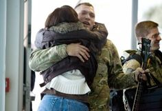 Staff Sgt. Joe McFarlan embraces his wife Kim Tuesday at the Klamath Falls Airport after Joe's flight arrived from San Francisco. He had been deployed to Afghanistan with the Oregon Air National Guard 173rd Fighter Wing's security forces.