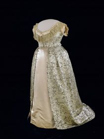Julia Grant's Evening Gown  Julia Grant wore this white silk damask evening gown in the early 1870s. According to the Grant family, the rose-patterned fabric was a gift from the emperor of China. The underskirt is a prop.