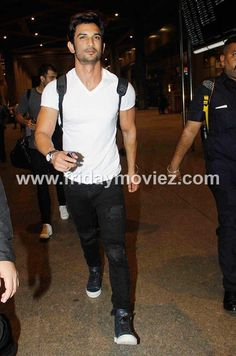 M S Dhoni and Sushant Singh Rajput at the airport