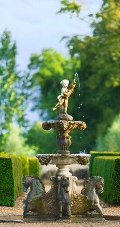 "Designer Creates A Relaxed Outdoor Retreat In the formal garden, hedges define ""rooms,"" some with architectural features such as fountains.In the formal garden, hedges define ""rooms,"" some with architectural features such as fountains. Landscaping With Fountains, Garden Fountains, Fountain Garden, Garden Landscaping, Dream Garden, Garden Art, Garden Design, Formal Gardens, Outdoor Gardens"