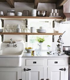 An extra-deep farmhouse sink and convenient shelving make clean up a breeze in this cottage kitchen Farmhouse Sink Kitchen, New Kitchen, Kitchen Dining, Kitchen Decor, Farm Sink, Micro Kitchen, Kitchen Ideas, Space Kitchen, French Kitchen