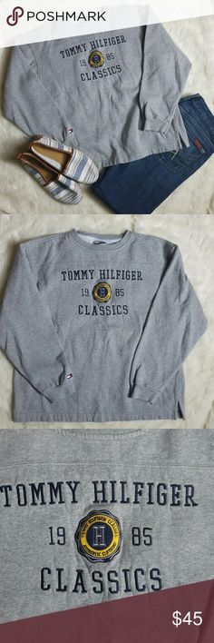 Vintage Tommy Hilfiger Sweatshirt Super trendy vintage sweatshirt from Tommy Hilfiger.  In pristine condition.  Size Medium but looks small.  Would look great as a crop top!! Tommy Hilfiger Tops Sweatshirts & Hoodies