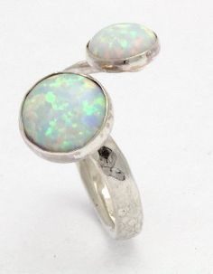 sterling silver hammered ring set with 6 and green opal stones. Handmade in the UK by Lavan Jewellery. Opal Rings, Gemstone Rings, Silver Rings, Hammered Silver, Sterling Silver, White Opal Ring, Green Opal, Stones, Jewellery