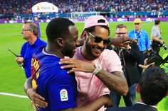 NBA players Draymond Green of the Golden State Warriors and Carmelo Anthony of the New York Knicks attend the International Champions Cup 2017 match between Real Madrid and Barcelona at Hard Rock Stadium on July 29, 2017 in Miami Gardens, Florida.