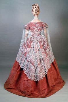 Moiré silk taffeta dress worn with shawl of Brussels lace, 1850s, KSUM 1983.1.62 (dress) and 1983.1.2288 (shawl).