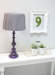 Rich plum painted lamp with gray gathered drum shade.