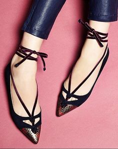 Black lace up flats.